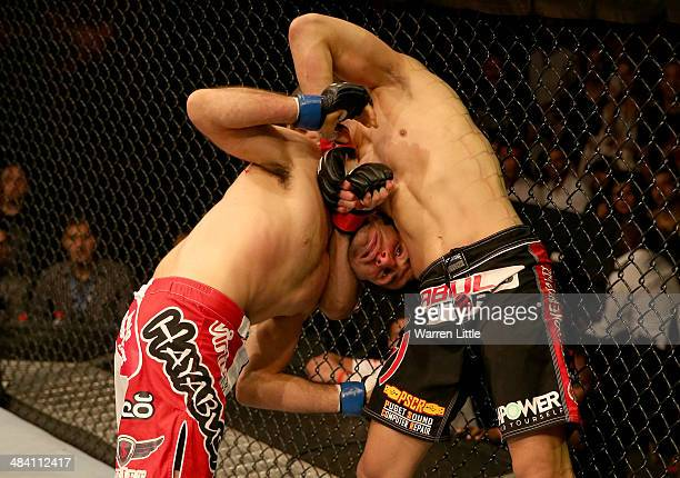 Beneil Dariush looks over as he is being held by Ramsey Nijem during their bout during UFC Fight Night 39 at du Arena on April 11, 2014 in Abu Dhabi,...