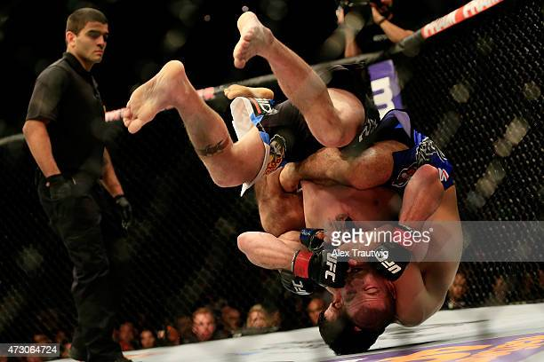 Beneil Dariush of Iran and Jim Miller fight in their lightweight bout during the UFC Fight Night event at Prudential Center on April 18 2015 in...