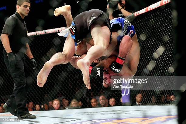 Beneil Dariush of Iran and Jim Miller grapple in their lightweight bout during the UFC Fight Night event at Prudential Center on April 18, 2015 in...