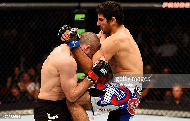 Beneil Dariush of Iran knees Jim Miller in their lightweight bout during the UFC Fight Night event at Prudential Center on April 18 2015 in Newark...