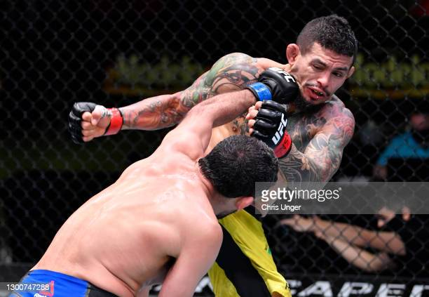 Beneil Dariush of Iran punches Diego Ferreira of Brazil in their lightweight fight during the UFC Fight Night event at UFC APEX on February 06, 2021...