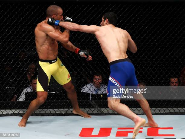 Beneil Dariush of Iran punches Edson Barboza of Brazil in their lightweight bout during the UFC Fight Night event at CFO Centro de Formaco Olimpica...