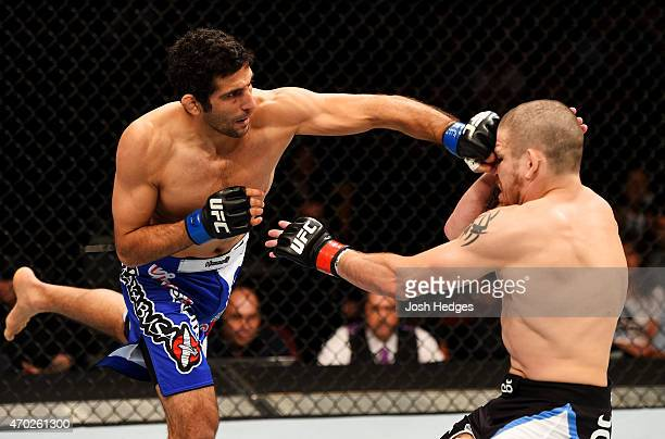 Beneil Dariush of Iran punches Jim Miller in their lightweight bout during the UFC Fight Night event at Prudential Center on April 18 2015 in Newark...