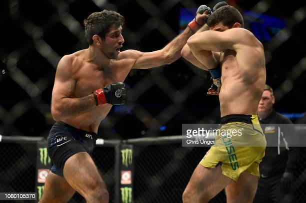 Beneil Dariush of Iran punches Thiago Moises of Brazil in their lightweight bout during the UFC Fight Night event inside Pepsi Center on November 10...