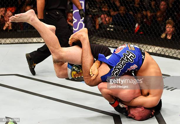 Beneil Dariush of Iran takes down Jim Miller in their lightweight bout during the UFC Fight Night event at Prudential Center on April 18 2015 in...