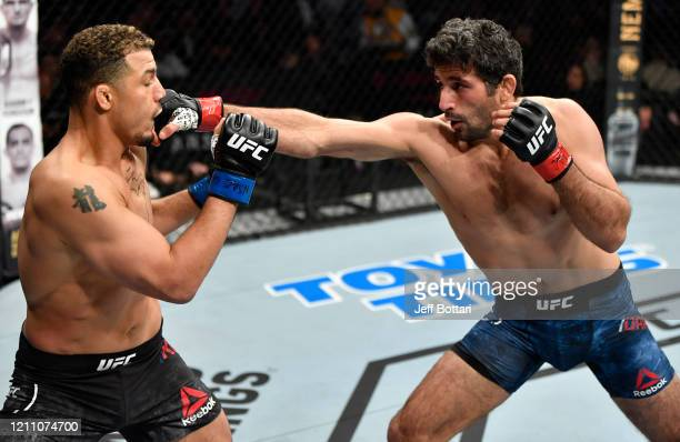 Beneil Dariush punches Drakkar Klose in their lightweight fight during the UFC 248 event at T-Mobile Arena on March 07, 2020 in Las Vegas, Nevada.