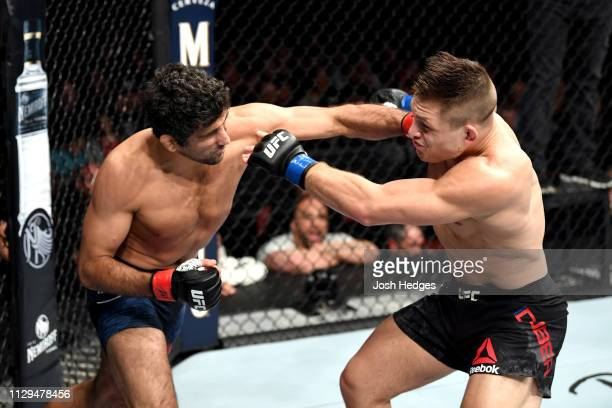 Beneil Dariush punches Drew Dober in their lightweight bout during the UFC Fight Night event at Intrust Bank Arena on March 9, 2019 in Wichita,...