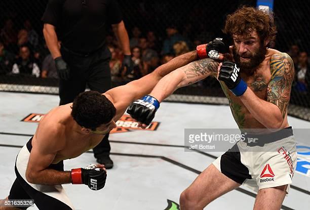 Beneil Dariush punches Michael Chiesa in their lightweight bout during the UFC Fight Night event at Amalie Arena on April 16, 2016 in Tampa, Florida.