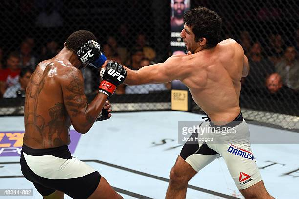 Beneil Dariush punches Michael Johnson in their lightweight bout during the UFC Fight Night event at Bridgestone Arena on August 8 2015 in Nashville...