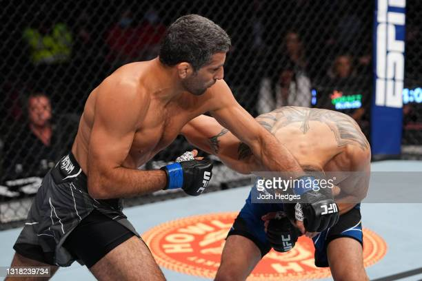 Beneil Dariush punches Tony Ferguson in their lightweight bout during the UFC 262 event at Toyota Center on May 15, 2021 in Houston, Texas.