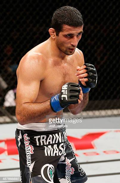 Beneil Dariush stands in the Octagon during his lightweight bout against Diego Ferreira of Brazil during the UFC 179 event at Maracanazinho on...