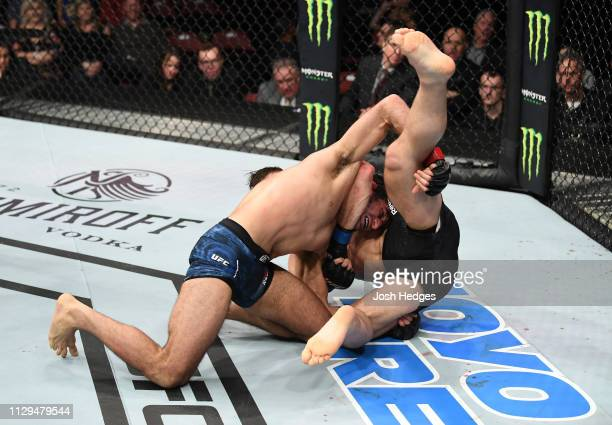 Beneil Dariush takes down Drew Dober in their lightweight bout during the UFC Fight Night event at Intrust Bank Arena on March 9, 2019 in Wichita,...