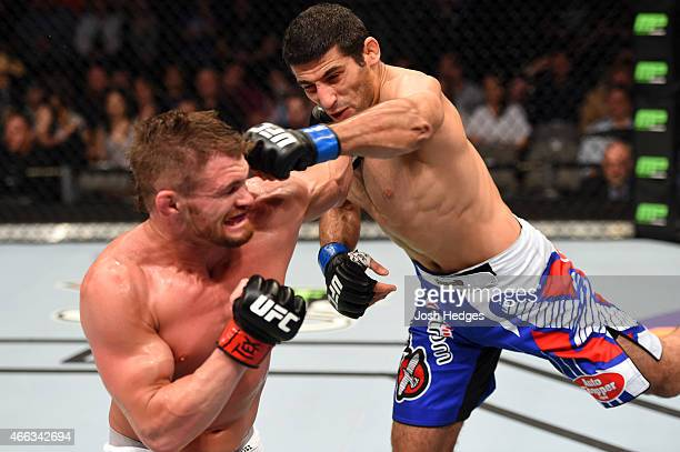 Beneil Dariush throws a flying superman punch against Daron Cruickshank in their lightweight bout during the UFC 185 event at the American Airlines...