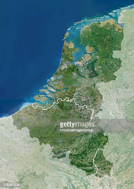 Benelux region Satellite image of the Benelux region of Europe with mask North is at top Water is blue vegetation is green urban areas are grey and...