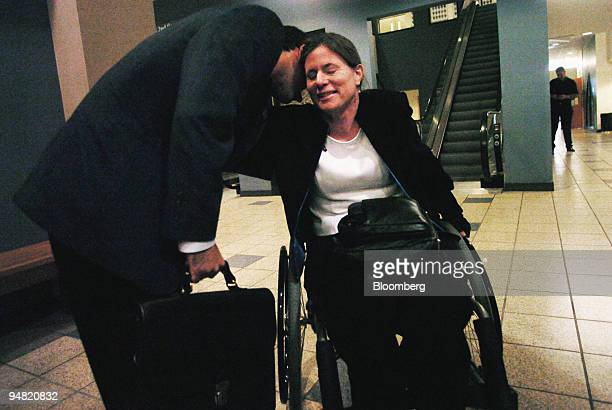 Benetta BuellWilson right shares a moment with her attorney Lou Arnell at San Diego Superior court on Thursday June 3 2004 in California Ford Motor...