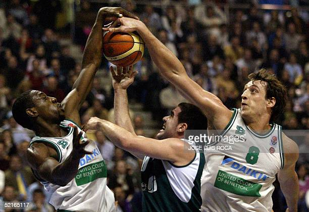0024abb799 Benetton Treviso's Denis Marconato and Paccelis Morlende vies with Carlos  Cabezas of Spanish Unicaja during ar