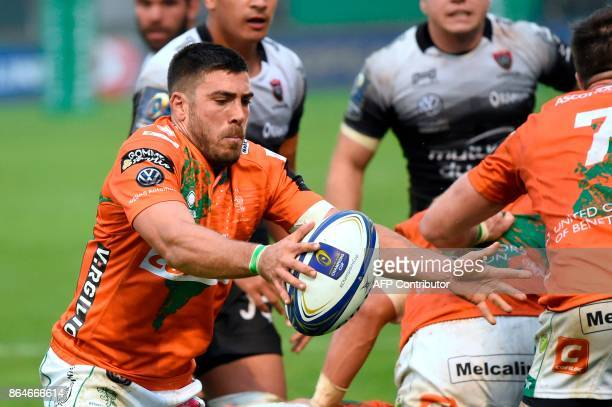 Benetton Treviso's Italian scrum half Edoardo Gori catches the ball during the European Rugby Champions Cup rugby union match between Benetton...