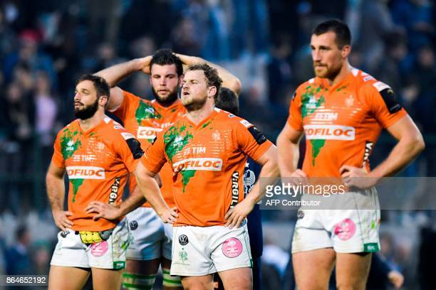Benetton Treviso's prop Tomas Baravalle centre Alberto Sgarbi and teammates react after the European Rugby Champions Cup match Benetton Treviso vs RC...