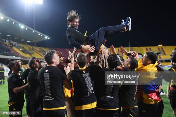 Benevento Calcio players let Pasquale Foggia, Benevento Calcio sports director, jump celebrating the victory of the Serie B after the serie B match...