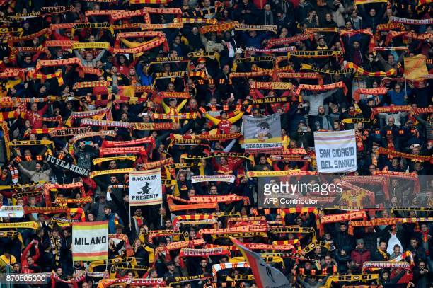 Benevento' supporters cheer during the Italian Serie A football match Juventus vs Benevento at the Juventus stadium in Turin on November 5 2017 / AFP...