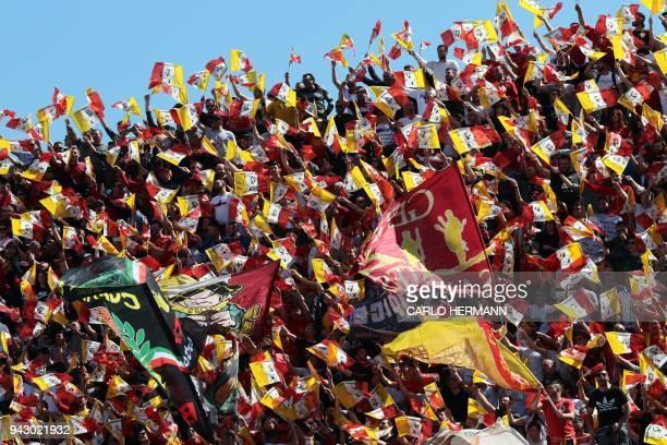 Benevento's fans cheer during the Italian Serie A football match Benevento Calcio vs FC Juventus on March 7 2018 at the Ciro Vigorito Stadium / AFP...