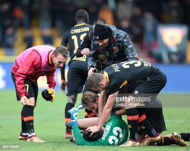 Benevento's Italian goalkeeper Alberto Brignoli is congratulated by teammates after scoring during the Italian Serie A football match Benevento...