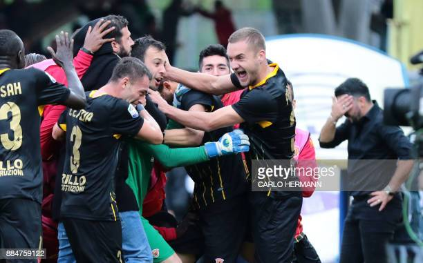Benevento's Italian goalkeeper Alberto Brignoli is congratulated by teammates after scoring as AC Milan's coach Gennaro Gattuso reacts during the...