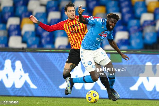 Benevento's Italian midfielder Nicolas Viola challenges for the ball with SSC Napoli's French midfielder Tiemoue Bakayoko during the Serie A football...