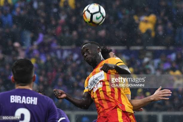 Benevento's midfielder Bacary Sagna jumps for the ball during the Italian Serie A football match Fiorentina vs Benevento on March 11 2018 at the...