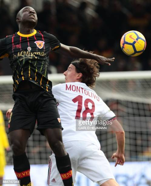 Benevento's midfielder Raman Chibsah fights for the ball with AC Milan's midfielder Riccardo Montolivo during the Italian Serie A football match...