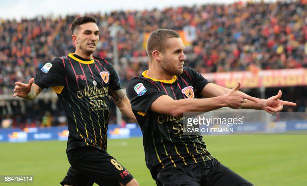 Benevento's Romanian forward George Puscas celebrates with teammate Benevento's midfielder Danilo Cataldi after scoring during the Italian Serie A...