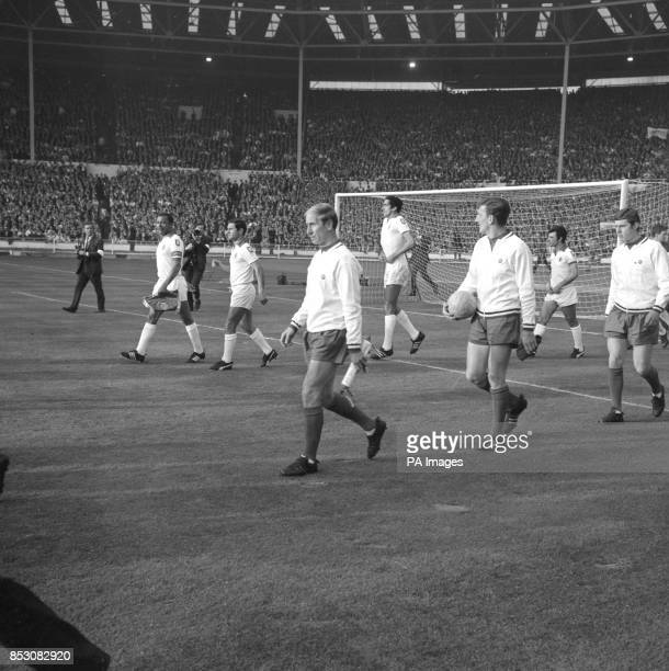 Benfica captain Mario Coluna and Manchester United captain Bobby Charlton lead their teams out on to the field for the 1968 European Cup Final held...