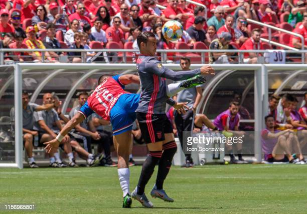 Benfica CenterForward Raul de Tomas heads off a pass around Guadalajara defender Miguel Angel Ponce during the International Champions Cup between SL...