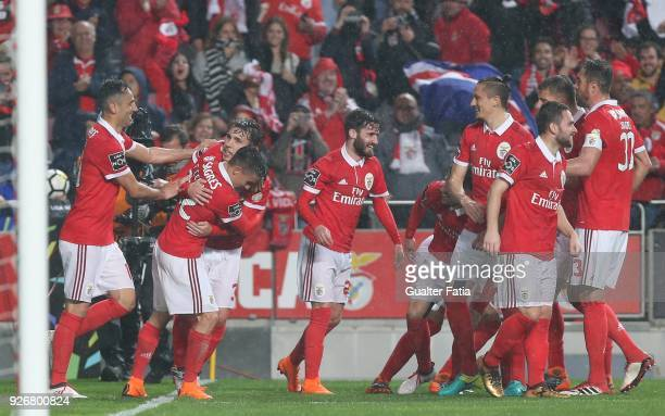 Benfica defender Alejandro Grimaldo from Spain celebrates with teammates after scoring a goal during the Primeira Liga match between SL Benfica and...