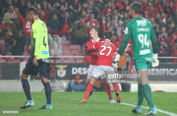 Benfica defender Alejandro Grimaldo from Spain celebrates with teammate SL Benfica forward Rafa Silva from Portugal after scoring a goal during the...