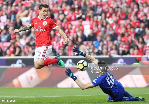 Benfica defender Alejandro Grimaldo from Spain with Vitoria Guimaraes goalkeeper Miguel Silva from Portugal in action during the Primeira Liga match...