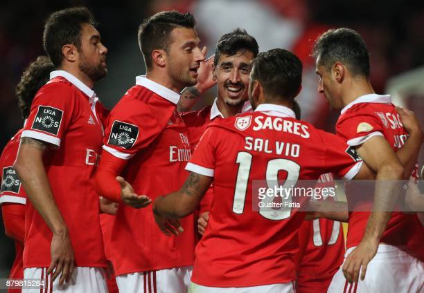 Benfica defender Andre Almeida from Portugal celebrates with teammates after scoring a goal during the Primeira Liga match between SL Benfica and...
