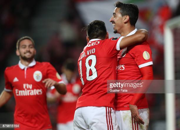 Benfica defender Andre Almeida from Portugal celebrates with teammate SL Benfica forward Eduardo Salvio from Argentina after scoring a goal during...
