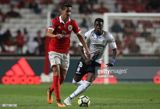 Benfica defender Andre Almeida from Portugal with CD Feirense forward Jose Valencia from Colombia in action during the Primeira Liga match between SL...