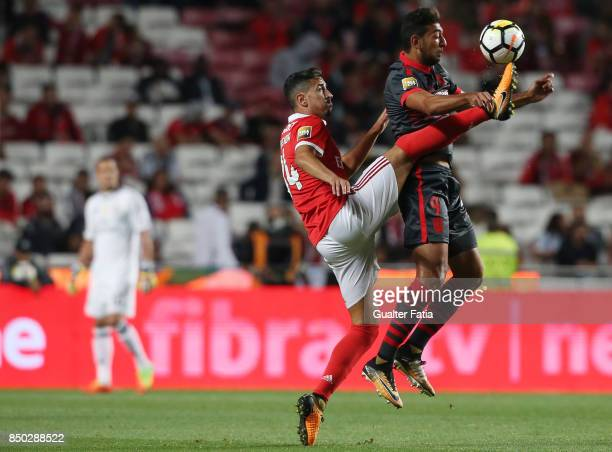 Benfica defender Andre Almeida from Portugal with SC Braga forward Ahmed Hassan from Egypt in action during the Portuguese League Cup match between...