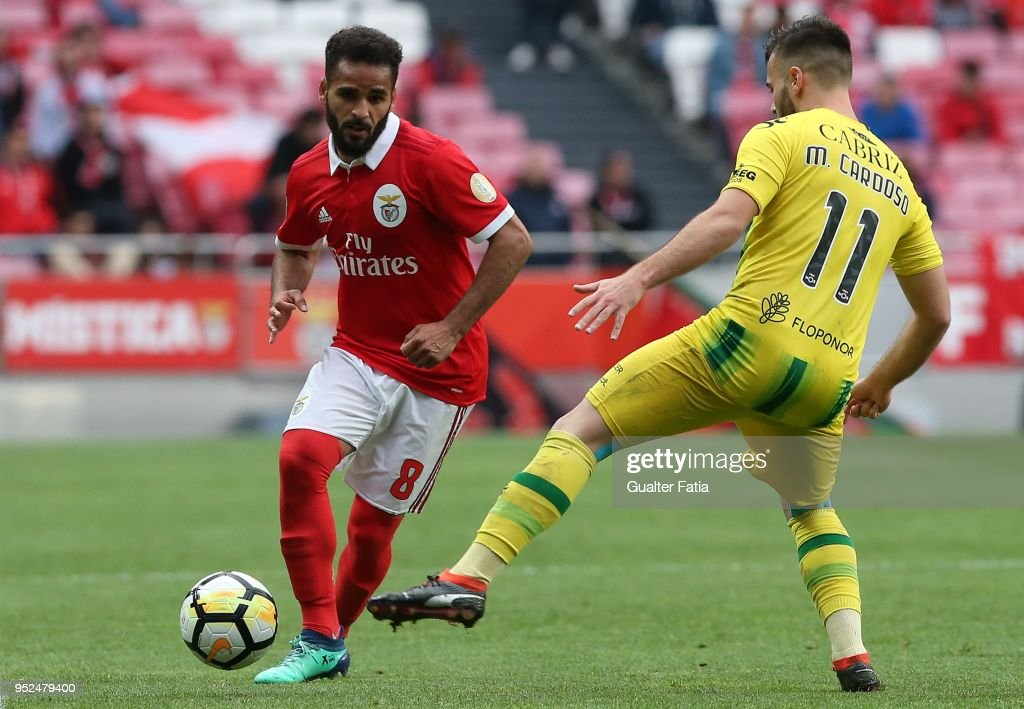 SL Benfica defender Douglas from Brazil with CD Tondela forward Miguel Cardoso from Portugal in action during the Primeira Liga match between SL Benfica and CD Tondela at Estadio da Luz on April 28, 2018 in Lisbon, Portugal.