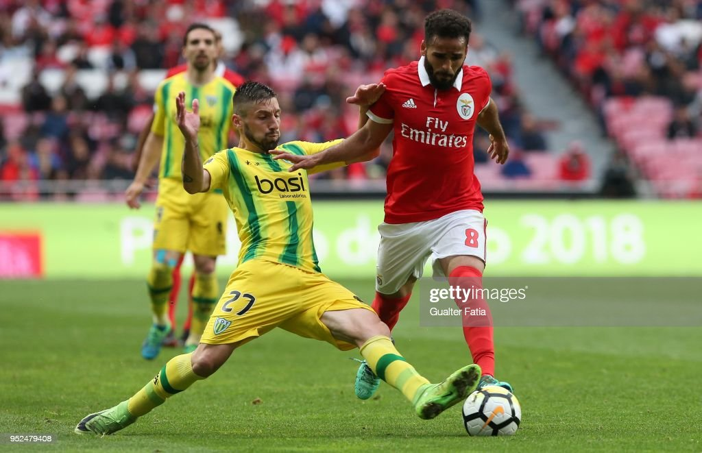 SL Benfica defender Douglas from Brazil with CD Tondela midfielder Bruno Monteiro from Portugal in action during the Primeira Liga match between SL Benfica and CD Tondela at Estadio da Luz on April 28, 2018 in Lisbon, Portugal.