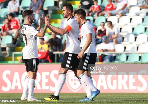 Benfica defender Jardel from Brazil celebrates with teammates after scoring a goal during the PreSeason Friendly match between SL Benfica and FK...