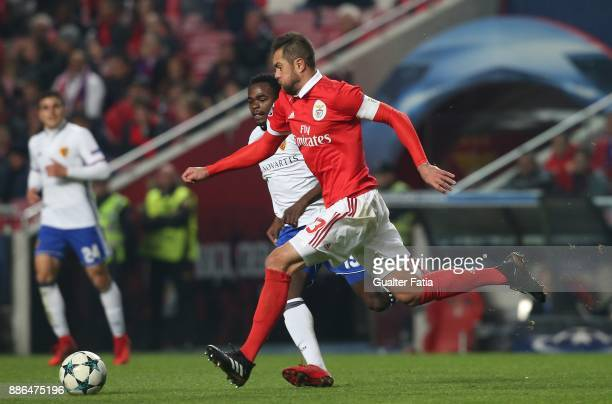 Benfica defender Jardel Vieira from Brazil with FC Basel forward Dimitri Oberlin from Switzerland in action during the UEFA Champions League match...