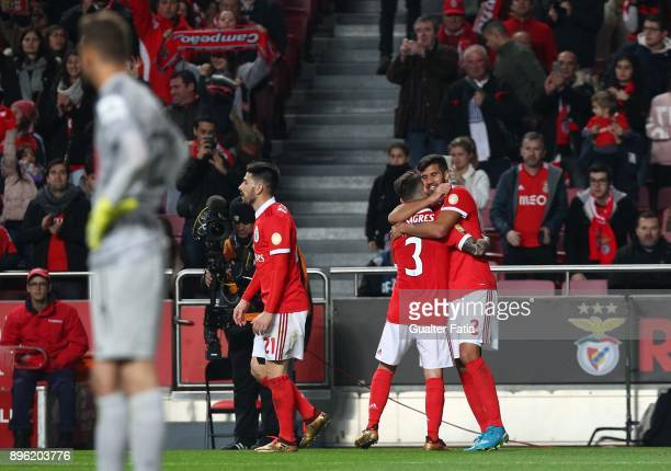 Benfica defender Lisandro Lopez from Argentina celebrates with teammates after scoring a goal during the Portuguese League Cup match between SL...