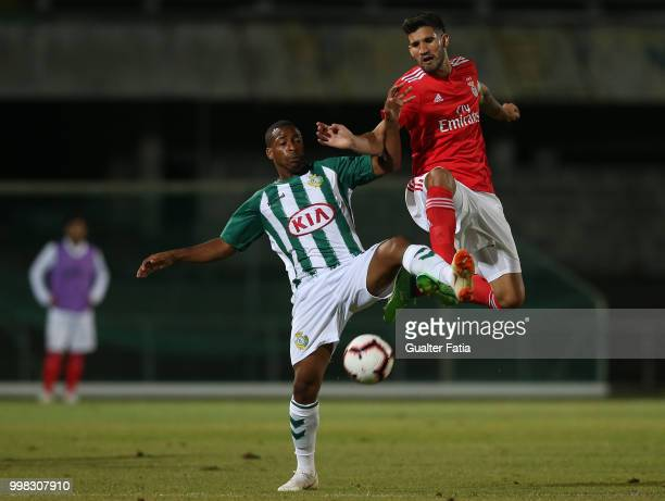 Benfica defender Lisandro Lopez from Argentina with Vitoria Setubal forward Allef from Brazil in action during the PreSeason Friendly match between...