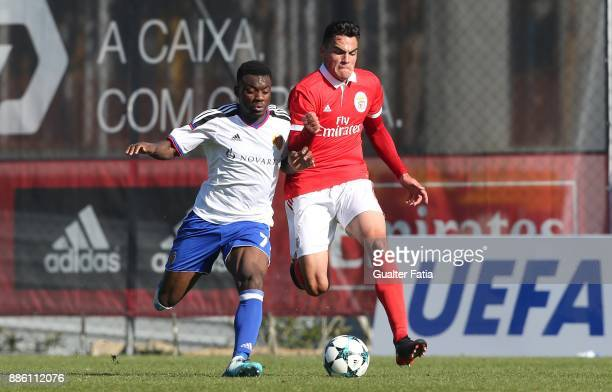 Benfica defender Pedro Alvaro from Portugal with Basel forward Afimico Pululu from France in action during the UEFA Youth League match between SL...