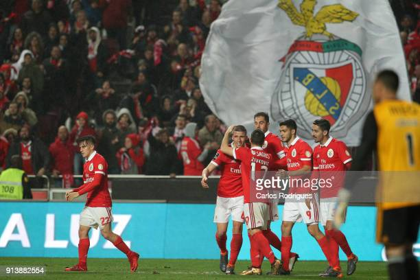 Benfica defender Ruben Dias from Portugal celebrates scoring Benfica fourth goal with his team mates during the match between SL Benfica and Rio Ave...