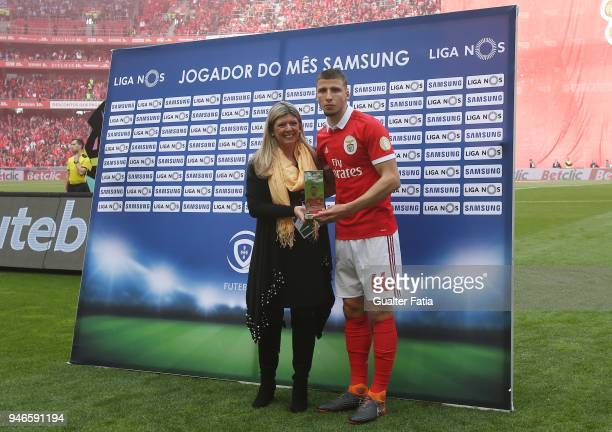 Benfica defender Ruben Dias from Portugal receives the award for best defender in the month of March in the Portuguese Primeira Liga before the start...