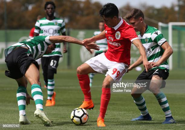 Benfica defender Simon Ramirez from Chile with Sporting CP B midfielder Miguel Luis and Sporting CP B midfielder Paulinho in action during the...